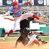 Michael McKinney, of Independence, jumps over Bryce Rhodes, of North Marion slidding save into second base during the semi-final State Baseball Tournament held at Appalachian Power Park in Charleston Friday morning.<br /> (Rick Barbero/The Register-Herald)
