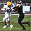 Ian Cline, of Greenbrier East, left, tries to get away from, Tyiai Kimble, of Woodrow Wilson during game at VanMeter Stadium in Beckley Friday night.<br /> (Rick Barbero/The Register-Herald)