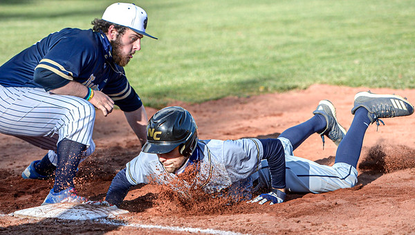 Shady Spring Firstbaseman Hunter Ritchie, left, is late on the tag as Nicholas County's Rylee Nicholas slides in safely during Monday action at Shady Spring. F. Brian Ferguson