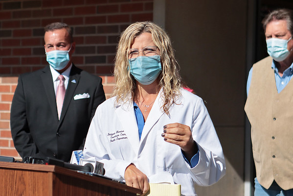 """Dr. Bridgett Morrison, health officer for the Greenbrier County Health Department, issues a """"desperate plea"""" to the public to wear masks and get vaccinated Friday in Fairlea. The hospital systems are at capacity locally and state wide.  """"This isn't propaganda, this isn't fear tactics, this isn't politics - this is what we are seeing,"""" she said.  Jenny Harnish/The Register-Herald"""