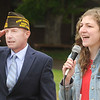 Kevin Meadows salutes the flag as Lindsey Palmer, 17 year-old Independence High student,  sings the National Anthem at a Memorial Day service held in Coal City. Jon C. Hancock/for The Register-Herald