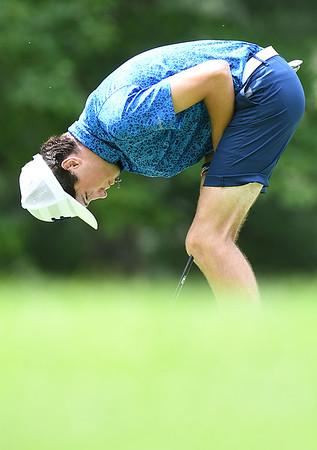 Todd Duncan reacts after just missing a birdie putt on the par 3, 17th hole during the final round of the Mountain State Golf Classic held on the Cobb course Monday.<br /> (Rick Barbero/The Register-Herald)