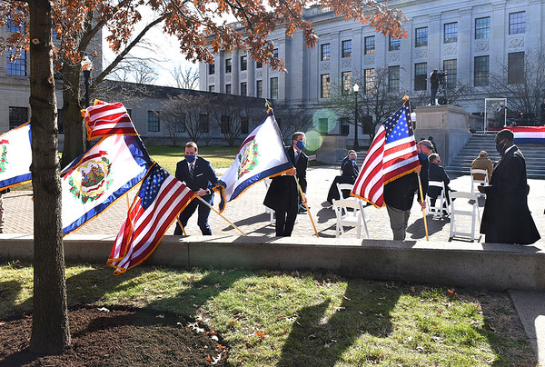 A strong wind blew over several flags at Governor Jim Justice's inauguration ceremonty for his second term as the 36th Governor of the State at the West Virginia Capitol in Charleston on Friday. They were quickly uprighted.  (Craig Cunningham/The Register-Herald)