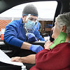 Dr. Lanny Meadows, Access Health, administers a dose of the Phizer vaccine to Nancy Culicerto, of Beckley, during  a drive-thru COVID-19 vaccine clinic held Friday, January 8 from 9:00am-3:00pm at the Beckley Raleigh County Convention Center. This clinic provided 650 vaccines for 80 and over population of Raleigh County.<br /> (Rick Barbero/The Register-Herald)
