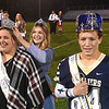 Logan Vandall, second from left, crowned, Braelee Brown, left, as homecoming queen and Chase McClung as king, before the start of the game between Greenbrier West and James Monroe Friday evening at Greenbrier West High School.