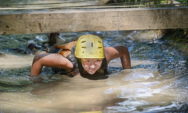 Girl Scout Miley Ragsdale made the trip from Indiana to battle her way through the mud course on Monday at Ace Adventure Resort in Oak Hill. F. Brian Ferguson/Register-Herald