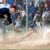 Michael McKinney of Independence sliding in safe at home under Gavin Lail of Bluefield.<br /> Tina Laney/for The Register-Herald