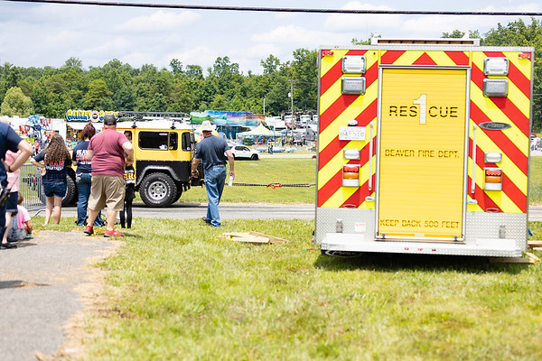 Just before the Burnout contest Pat Crager in his 1977 Land Cruiser pulls out the Beaver Fire and Rescue Engine 1 after being stuck in the mud at the Friends of Charity Auto Fair.<br /> Tina Laney/for The Register-Herald