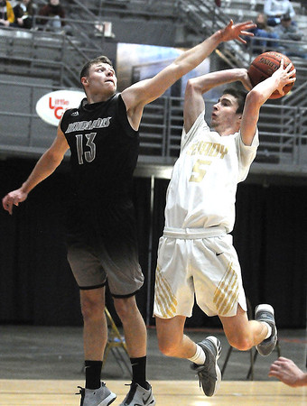 Westside's Evan Collucci tries to block a jumpshot from Shady's Cole Chapman during the first half. Jon C. Hancock/for The Register-Herald