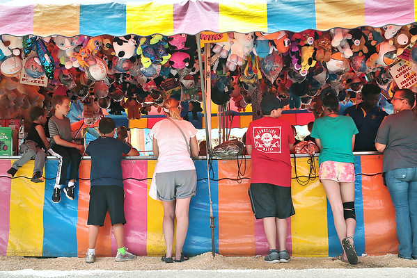 Fair goers play for prizes at Fat Alberts at the State Fair of West Virginia in Fairlea Wednesday. Jenny Harnish/The Register-Herald