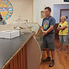 Customers wait in line at Good Roads Bakery on opening day in Frankford Saturday. Jenny Harnish/The Register-Herald