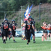 Summers County football team runs onto the field at the start of Friday's game against Greenbrier West at Summers County High School. Jenny Harnish/The Register-Herald