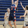 Independence's Emily Suddreth pulls down a rebound as Shady Spring's Ashleigh Gabburt defends during Wednesday evening action in Shady Spring' F. Brian Ferguson