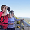 Mother and daughter Linda Goodwin and Jilynn Parmly look for birds on the top of Bolar Lookout Tower in Pipestem Resort State Park Monday. The family travelled from Tennessee to spend time exploring West Virginia. Jenny Harnish/The Register-Herald