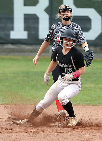Wyoming East's Lilly Hill makes it to second for a double.