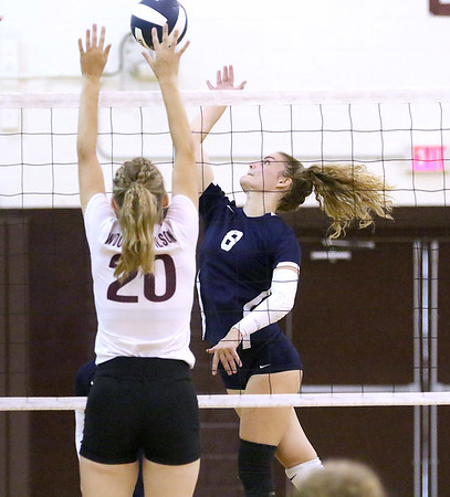 (Brad Davis/For The Register-Herald) Shady Spring's Peydon Smith attacks as Woodrow Wilson's Emily Stack tries to block during Shirley Brown Invitational action Saturday morning in Beckley.
