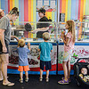 F. Brian Ferguson/Register-Herald  The Richman famiily, from left, mother Samantha, Soloman. 2, Abraham, 4, Laila, 8, and Myles, 5-months, choose their flavors at Melting Memories Ice Cream