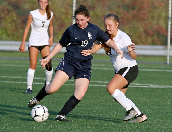 (Brad Davis/For The Register-Herald) Shady Spring's Mallie Lawson battles for possession with Oak Hill's Peyton Light Monday evening at the YMCA Paul Cline Memorial Sports Complex.
