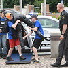 Lt. W.R. Killen, Raleigh County Sheriff Dept., right observes, John Brandstetter, 14, of Lester, left, Anthony Hinkle, 11, of Beckley, and Nicholi Branner, 11, of Shady Spring, carry a dummy downed officer during an excercise held during Beckley City Police Junior Police and Leadership Academy. The Academy is a one week program designed to increase a better understanding between students and the police through education. Students will learn from law enforcement officers in the classroom, durin.  Students will have a better understanding of the day to day responsibilities and duties that officers are tasked with on a regular basis.<br /> <br /> The Junior Police and Leadership Academy will be held June 7-11, 2021 and June 28, 2021-July 2, 2021 at the Beckley Police Department, Woodrow Wilson High School, the Beckley Police Department and the Beckley Police Department Training Facility. The Academy times will be 8:30 a.m. to 4:00 p.m. There is no cost and it is open to elementary and middle school students (Current 5th through 8th grade). Students interested in attending the JPA must complete the Academy Application and the Agreement and Release forms.<br /> (Rick Barbero/The Register-Herald)