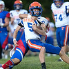 Tolsia running back, Eli Blackburn is brought down from behind by a Midland Trail defender. Chad Foreman for the Register-Herald.