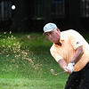 Mike Mays hits from the trap on the par 3, 7th hole during the final round of the Mountain State Golf Classic held on the Cobb course Monday.<br /> (Rick Barbero/The Register-Herald)