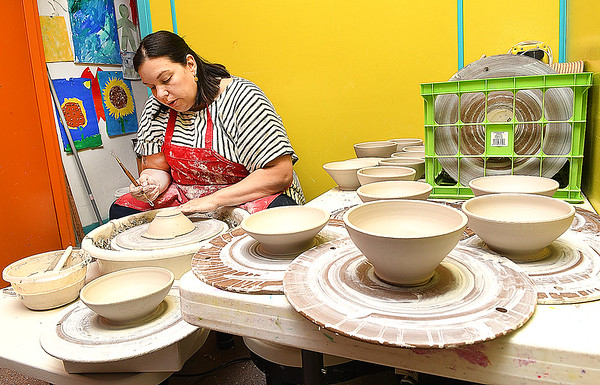 Norma Acord. artist & residence Youth Museum of Southern West Virginia, gettin an early start working on making bowls for the Empty Bowls fund raising event to be held March 26 at The Place in Beckley. Acord said, the goal is to produce 500 bowls that will be sold for $20. each and the proceeds will go to local food pantiies.<br /> (Rick Barbero/The Register-Herald)
