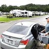 Ron Goodwin, of Beckley, loads up food he had in his refrigerator at Lake Stephens campground. The power was shut off at the campground due to an emergency electrical problem and campers were evacuated until further notice.<br /> Rick Barbero/The Register-Herald)