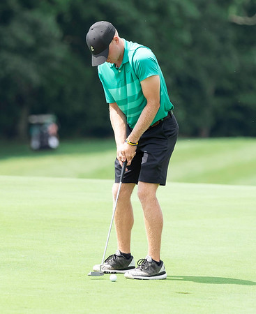Drew Greene putting for a Birdie on Hole 12 at the Grandview Country Club Mountain State Golf Tournament.<br /> Tina Laney/for The Register-Herald