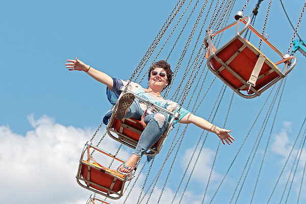 Reba Simmons, of Ronceverte, enjoys the YoYo ride at the State Fair of West Virginia on opening day in Fairlea Thursday. Jenny Harnish/The Register-Herald