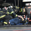 Fire fightersDepartment work on a passenger after being removed from a simulator airplane during a mock disaster plane wreck held at the Raleigh County Memorial Airport in Beaver Tuesday morning. This was a training excerise that's conducted every three years for airport employees to be FAA certifield.<br /> (Rick Barbero/The Register-Herald)