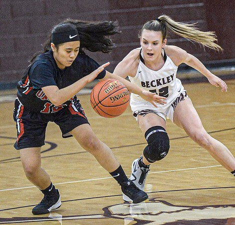 Oak Hill's Hannah White, left, and Woodrow Wilson's Cloey Frantz fight for the ball during Friday evening action in Beckley. F. Brian Ferguson