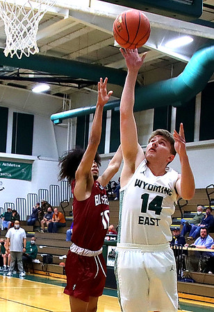Wyoming East's Jacob Howard goes up for two against Bluefields Chance Johnson.