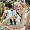 F. Brian Ferguson/Register-Herald Wyoming East's #11 Skylar Davidson embraces Abby Russell after the Lady Warriors beat Petersburg in the AA State Tournament on Friday morning. The Warriors will advance to the championship game on Saturday in Charleston.