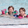 Twins Maizy, left, and Meadow Jackson enjoy the new White Sulphur Springs City Pool on Memorial Day Monday. The new pool and wellness center celebrated its opening Memorial Day weekend with free passes for White Sulphur Springs residents.  Jenny Harnish for the Register-Herald
