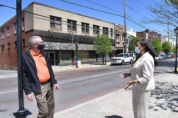 Beckley's Ward one councilmen Tom Sopher, left and ward five Janine Bullock, have a discussion in front of the 227 Prince Street building.<br /> (Rick Barbero/The Register-Herald)