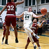 Tanner Whitten of Wyoming East goes up for two against Bluefield's Josiah Hicks.<br /> Jim Cook/for the Register-Herald