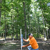 J.E. Daniel, maintenance foreman Lake Stephens, levels a post for the basket on the 2nd hole of the new Disc Golf Course getting installed at Lake Stephens.<br /> (Rick Barbero/The Register-Herald)