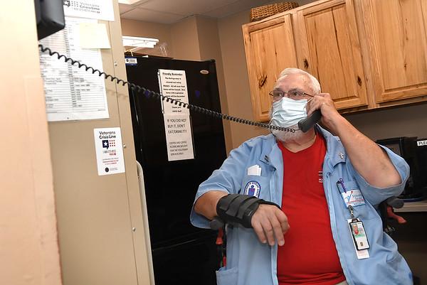 Jim Halsey, volunteer Beckley VA Medical Center, taking care of a request to escort a patient.<br /> (Rick Barbero/The Register-Herald)
