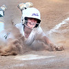 Greenbrier East's Aubrey Glover slides safely into home and helping win the Class AAA Region 3 softball game against St. Albans in Fairlea Monday.  Jenny Harnish for the Register-Herald