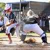 Independence's Allie Hypes scores at home around catcher Page Laxton of Wyoming East in the Class AA Region 3 Championship.<br /> Tina Laney for Register-Herald