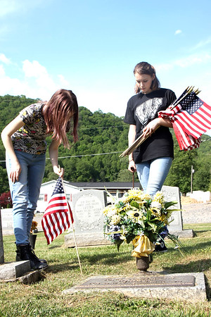 Westside FLP students Erin Cook and Caitlyn Gibson helping to place flags on veteran's graves at Palm Memorial Gardens in Matheny.