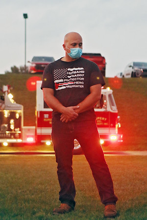Firefighter Captain Michael Johnston prays during a vigil at Greenbrier Valley Medical Center in Fairlea Tuesday.  The vigil was organized by Senator Stephen Baldwin, who is also President of the Greenbrier County COVID Task Force, to pray for patients and medical professionals battling the delta variant and to honor those who have lost their lives to the virus. Jenny Harnish/The Register-Herald