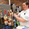 Tabbitha Mains, owner of Coffee On Main on Main Street in Beckley, prepares some hot tea adding vanilla, cream and sugar. <br /> (Rick Barbero/The Register-Herald)