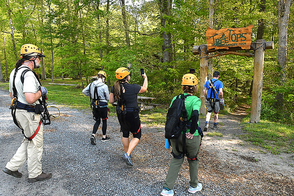 Member of the Freelance Council of the Society of American Travel Writers, take a hike to the TreeTops Zipline Canopy Tours at Adventure On The Gorge Wednesday morning. Forty-one Travel Writers are exploring and writing about West Virginia this week.<br /> (Rick Barbero/The Register-Herald)