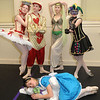 Alice, played by Carsyn Harris, sleeps in front of from left, Queen of Hearts, played by Alyssa Young, Mad Hatter, played by Brian Murphy, Caterpillar, played by Ashtin Bailey, and the Court Jester, played by Louie Boyd. Jon C. Hancock/for The Register-Herald