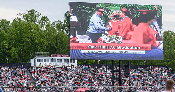 F. Brian Ferguson/Register-Herald  A mega screen allowed friends and family, who could not fit into John D. Duda Stadium, to view the Oak Hill 2021 Graduation on Saturday evening in Oak Hill.