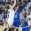 F. Brian Ferguson/Register-Herald Woodrow Wilson's Cloey Frantz, left, drives for the score as Capital's Natayla Bayles and Talayah Boxley defend during Wednesday evening action in Beckley.