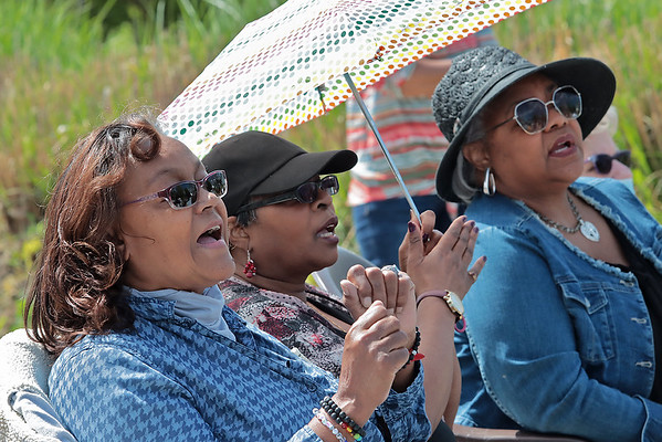"""From left, Elizabeth Davis, Ruth Catus and Jeannette Thomas sing along to Bill Withers' song """"Use Me"""" at the dedication of the new Bill Withers historical marker across from Stratton Elementary School in Beckley Saturday.  Jenny Harnish for the Register-Herald"""