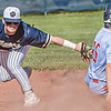 F. Brian Ferguson/Register-Herald  Shady Spring shortstop Thatcher Potcat is late on the tag as Independence's Clay Basham slides in safely to second base during Wednesday evening action in Shady Spring.