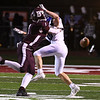 Maddex McMillen, of Woodrow Wilson, left, breaks up a pass attempt to Peyton Clemons, of Princeton during the first half Friday night at VanMeter Stadium in Beckley.<br /> (Rick Barbero/The Register-Herald)